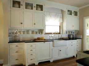 Kitchen with antique white shaker cabinets this quaint cottage kitchen