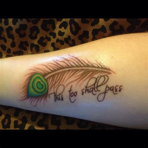 small feather tattoo        inked