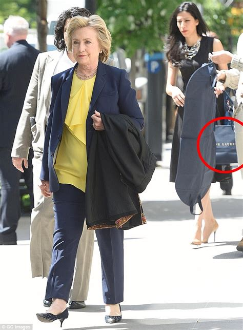 Hilary Bag clinton s aide carries designer shopping bags for