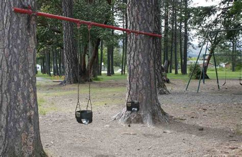 hanging a swing between two trees swing between two trees outdoor projects likes pinterest