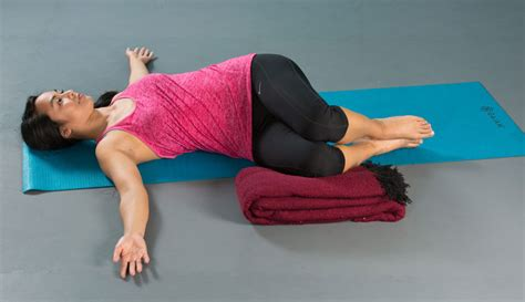 reclined spinal twist relaxation promoting restorative yoga routine