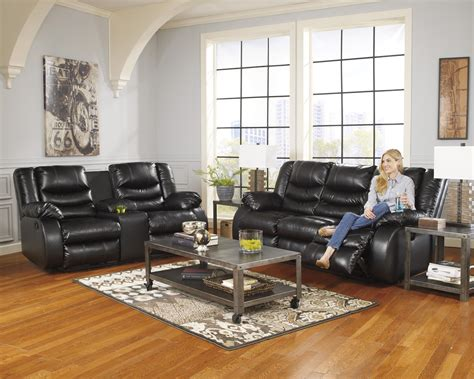 nairobi contemporary faux leather reclining sofa by benchcraft contemporary faux leather reclining sofa with pillow arms