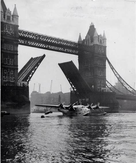 boat going under tower bridge seaplane flying under tower bridge london vintage