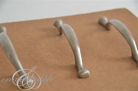 spray painting kitchen hardware how to paint kitchen cabinet hardware