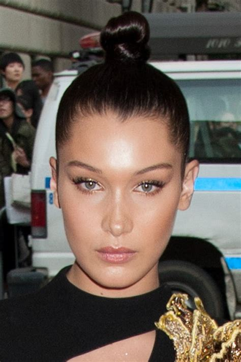 bella hadid straight dark brown bun hairstyle steal her