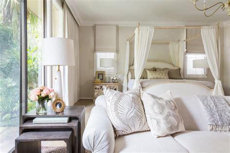 elegant white master suite features gold accents hgtv