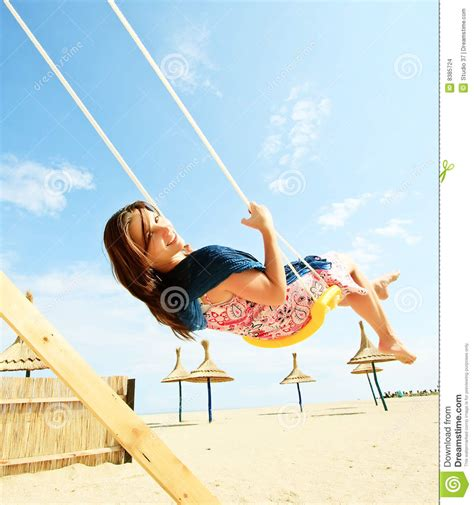 girl swinging on swing girl playing on a swing set stock images image 8385724