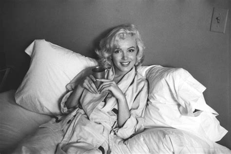 marilyn monroe in bed marilyn monroe in bed sticking her tongue out the cut