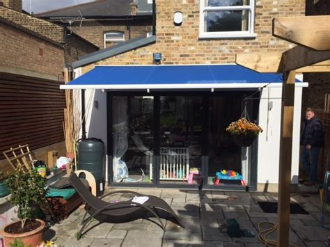 classic blinds and awnings more bifold doors shaded with the classic awning by deans