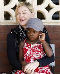 Adopt An Orphan Just Like Madonna madonna is serenaded as she takes adopted children david