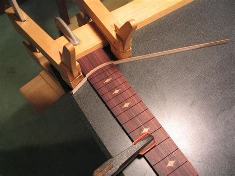 Should Fret If Photos Surface by Fretboard Slotting And Inlaying