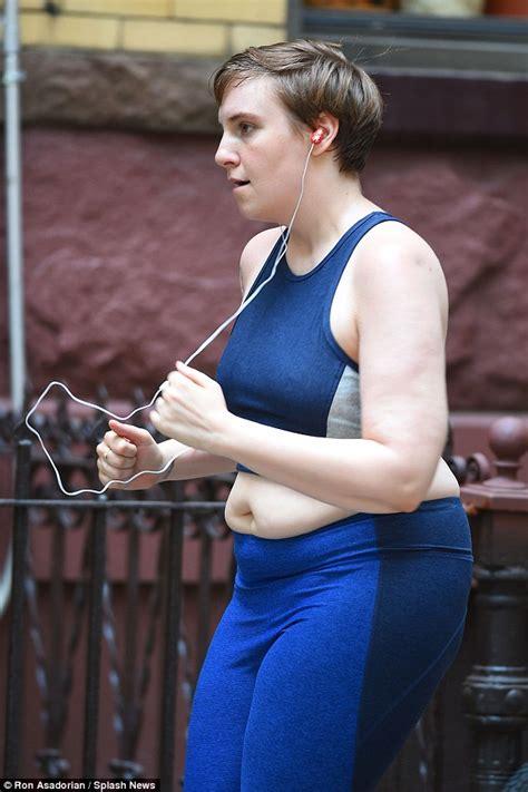 lena dunham exercise lena dunham limbers up in leggings and crop top on the set