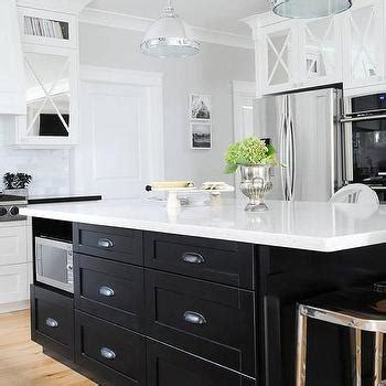 black kitchen island with black cup pull hardware transitional black metal and acrylic kitchen counter stools design ideas