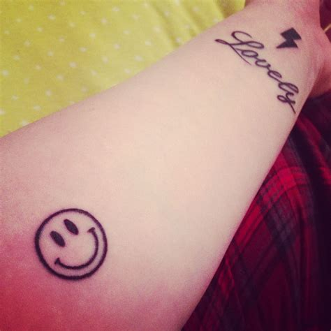 small smiley face tattoo my new tattoos i had the lovely and smiley fixed and