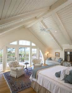 master bedroom with lofty beamed ceilings and arched skylights