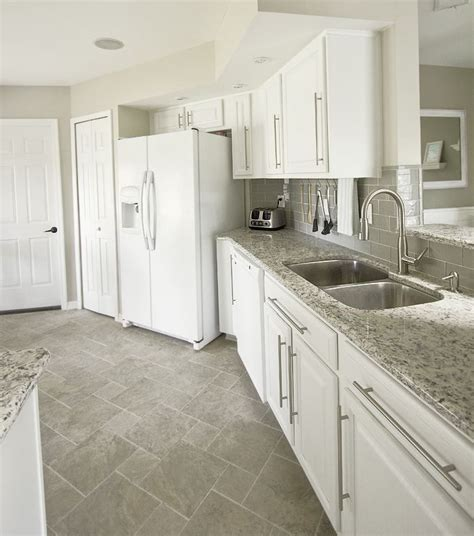 white tile floor kitchen white cabinets gray subway tile kashmir white granite