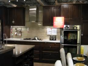 dark wood cabinets and light sand tones glass tile backsplash elegant kitchens granite countertop