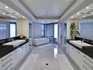 Modern bathroom design with spa bath using frameless glass
