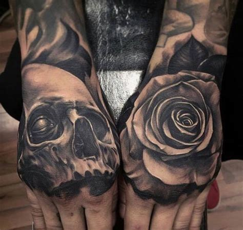 black and grey rose tattoo on hand 50 amazing rose hand tattoos