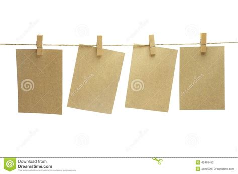 clip for brown paper hang on the rope with wooden clip stock photo