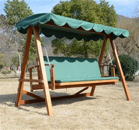 outsunny wooden garden 3 seater outdoor swing chair green