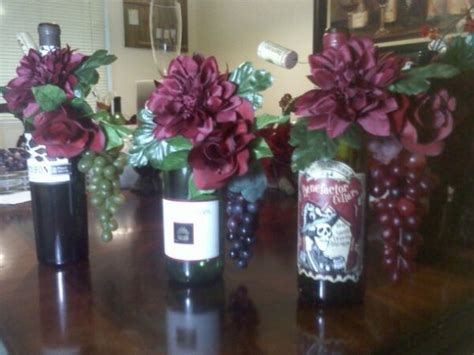 wine bottle wedding centerpieces with flowers inside