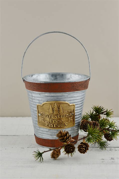 slim christmas tree in galvanized bucket galvanized 7 quot with handle tree farm logo