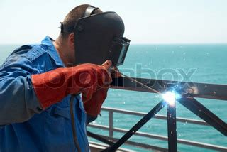 Kaos Welder Metal Workers welder at the factory working with metal construction stock photo colourbox