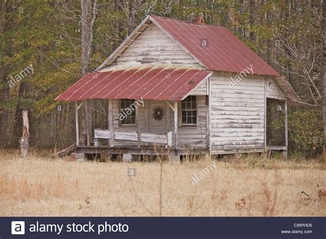 tin roof frame house with a tin roof and christmas wreath on the