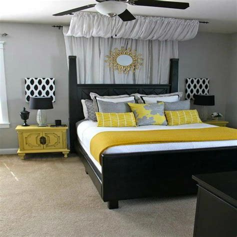 blue and yellow bedroom decor grey and blue wall black bed bed bedroom blue purple