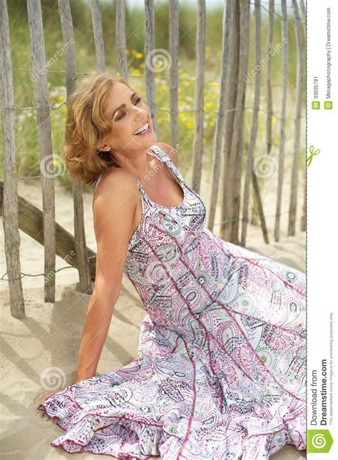 close up spread blonde slit beautiful middle aged woman smiling outdoors stock image