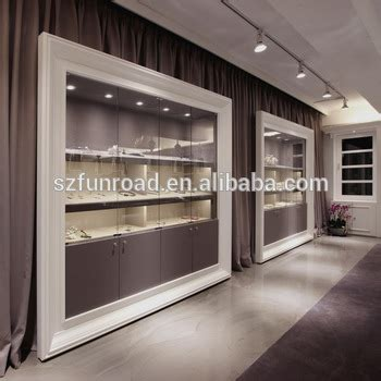 design photo wall display paint wall jewelry display stand with shelf in alibaba