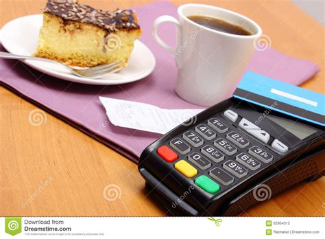 credit restaurants use payment terminal for paying for cheesecake and coffee