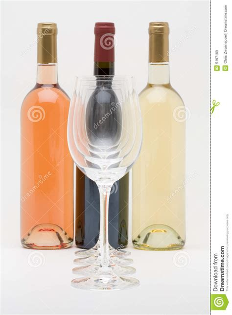 white and red rose wine glass red white and rose wine bottles with glasses royalty free