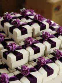 Favors For Wedding Reception by White Wedding Favor Box With Purple Ribbon And