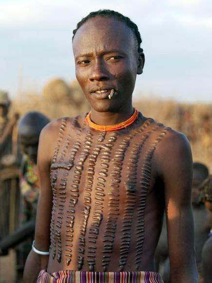 dassanech tribe man with crocodile like beautification