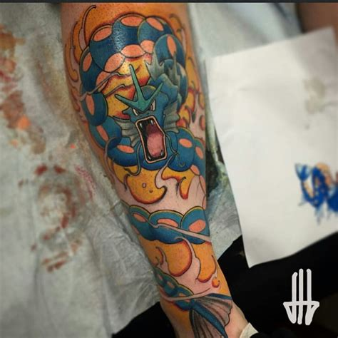 planet ink tattoo finished gyarados leg done by at planet