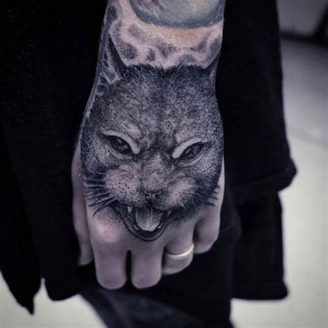 cat tattoo in hand cat hand tattoo best tattoo ideas gallery