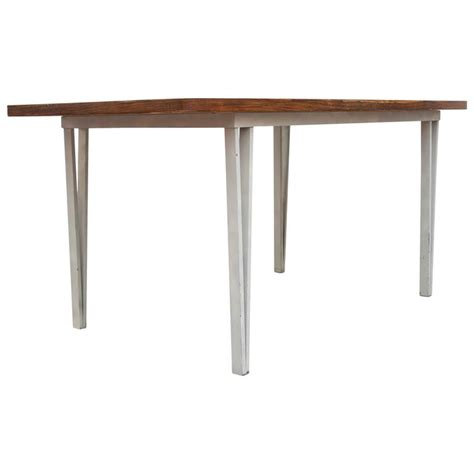 modern rosewood bowed top dining table with white