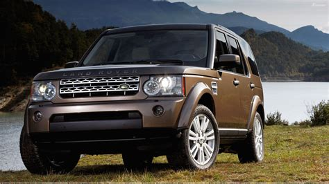 brown range rover land rover discovery 2010 in brown near hills wallpaper