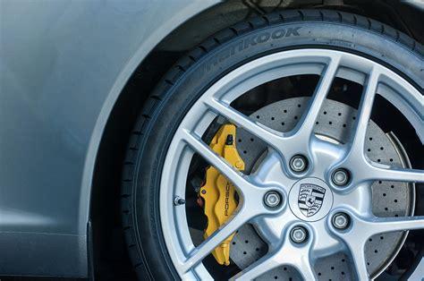 porsche wheel emblem 0626c photograph by reger