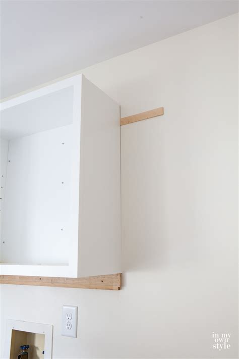 how to hang a kitchen cabinet mudroom update installing wall cabinets in my own style