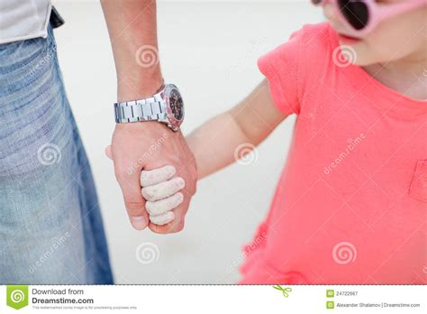 father and daughter holding hands royalty free stock