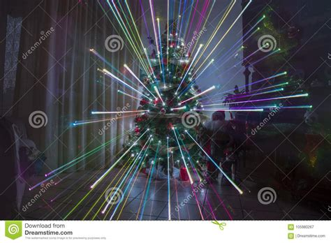 large firework effect christmas tree topper at home with fireworks effect and rainbow lights stock image image