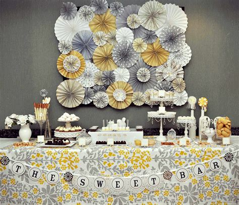 a romantic yellow gray dessert table hostess with the