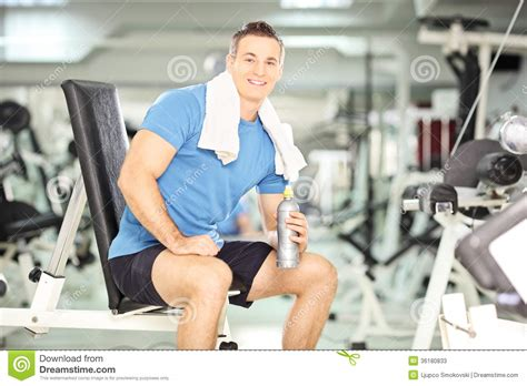 smiling man   bench drinking water  exercise