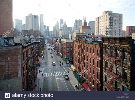 buy house in new york city new york city usa road and houses in two bridges neighborhood in stock photo