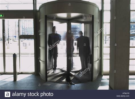 Rosie Exits Revolving Door Of The View by Business Entering A Revolving Door Stock Photo