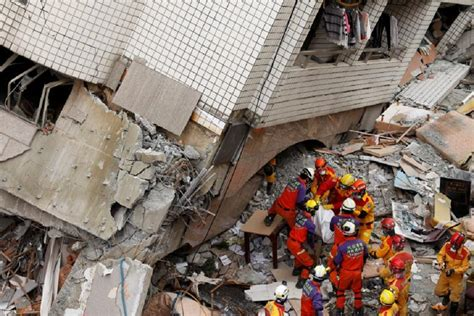earthquake hong kong taiwan quake toll rises to 14 as bodies pulled from rubble