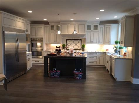 white gray glaze kitchen island with gray marble counter white perimeter cabinets with charcoal gray glaze with